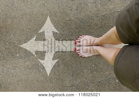 Women's Bare Feet On The Dirt Road