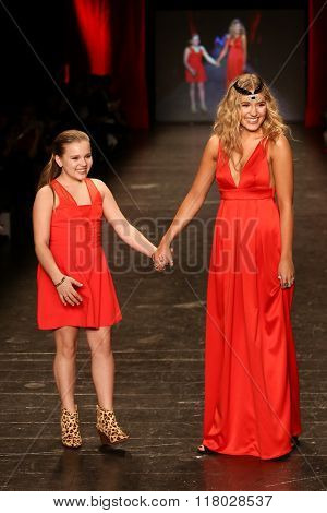 NEW YORK-FEB 11: Maisy Stella (L) and Lennon Stella wear BCBGeneration at Go Red for Women Red Dress Collection 2016 Presented by Macy's at New York Fashion Week on February 11, 2016 in New York City.