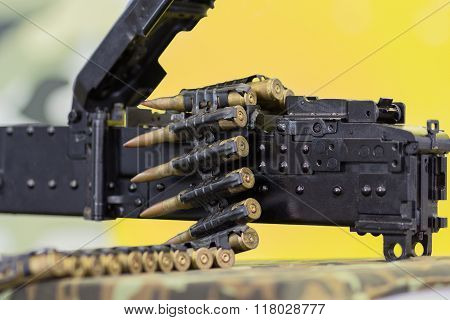 Tape With Bullets Tucked Into A Machine Gun. Weapon