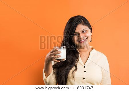 indian girl drinking milk, asian girl drinking milk, indian lady drinking milk, asian lady drinking