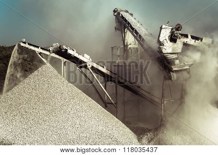 Working Gravel Crusher. Industrial Background