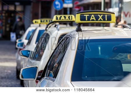 Taxis Are One Behind The Other At A Taxi Rank In Dusseldorf, Germany.