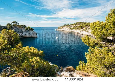 Boat leaves from bay to open sea in Calanques on the azure coast