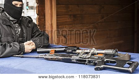 closeup photo showing a police sniper near his gun poster