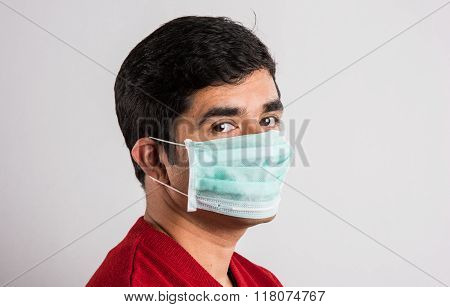 indian man wears mask, asian man wearing medical mask, young indian man wearing protective mask isol