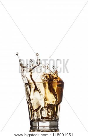 Glass of whiskey with splash, isolated on white background