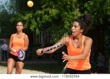 MOSCOW, RUSSIA - JULY 17, 2014: Women team Cyprus in the match against Switzerland during ITF Beach Tennis World Team Championship. Switzerland won the match 5-7, 6-2, 6-1