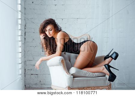 Perfect, sexy body, legs and ass of young woman wearing seductive lingerie