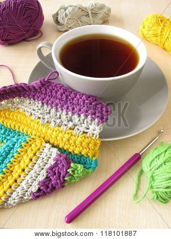 Crochet work and a cup of coffee