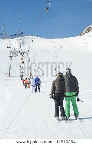 T Bar Ski Lift Pulling Skiers Up The Slope. Wide Slopes Of Austrian Glacier.