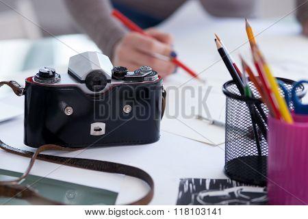 Cheerful female designer is working in studio