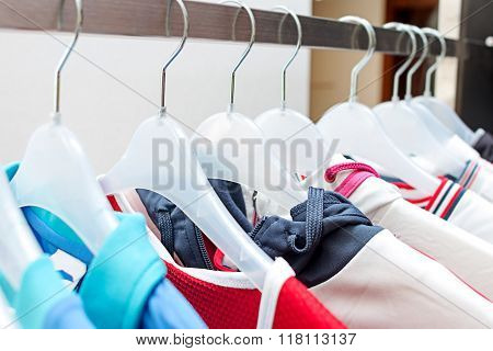 Sport clothes on hangers