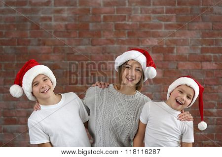 Happy cousins on brick wall background