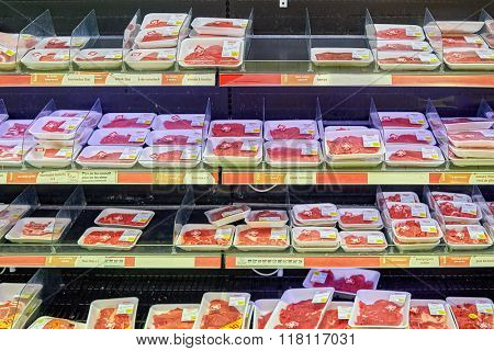 BEGLES, FRANCE - AUGUST 13, 2015: fresh meat at Simply Market supermarket. Simply Market is a brand of French supermarkets. This brand is a new concept to eventually replace Atac supermarkets