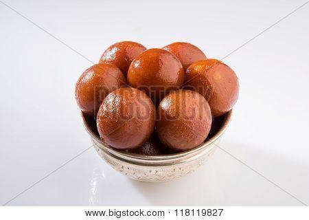 sweet gulab jamun indian dessert, indian sweet, asian sweet dish gulab jamun served in a silver bowl