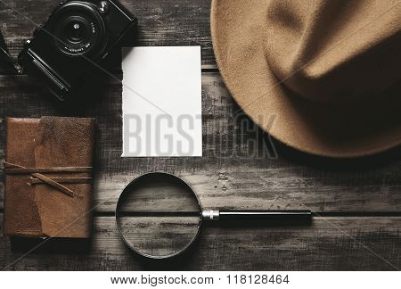 Photo Camera, Notebook, Hat, Magnifier, Paper On Black Table