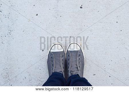 Converse chucks on concrete floor