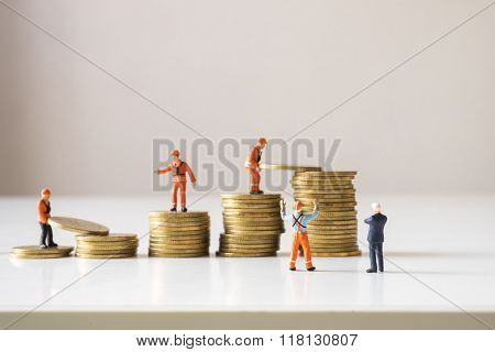 Businessman And Construction Site Manager Looking At Team Making Gold Coin Step Stair.