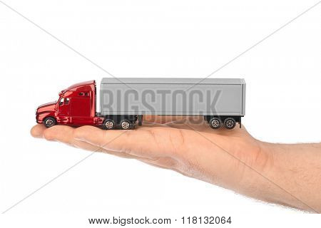 Toy car truck in hand isolated on white background
