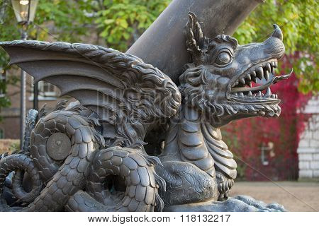 LONDON, UK - OCTOBER 4, 2016: Canon decorated with dragon,  Whitehall, Royal Horse Guard Palace