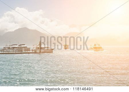 Landscape of famous attraction, Sun Moon Lake at Taiwan, with boats on dock at sunny day.