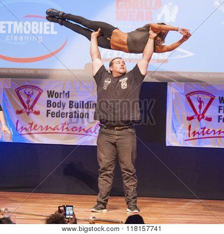 Belgium Strongman Jimmy Laureys Lifts Girls On Stage