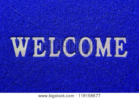 Welcome white mat isolated on blue background