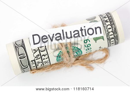 Money And Business Idea, The Dollar Bills Tied With A Rope, With A Sign - Devaluation