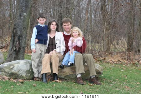 Happy Family Of Four People (1)