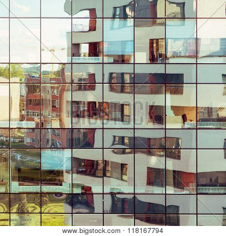 Modern Building Reflected On Glass Facade