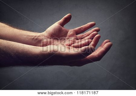 Hands reaching out concept for help, religion, salvation, forgiveness, assistance and love or begging
