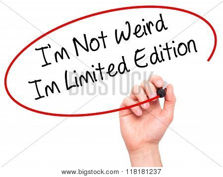 Man Hand Writing I'm Not Weird Im Limited Edition With Black Marker On Visual Screen