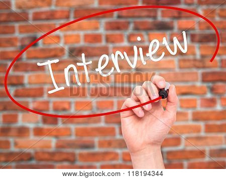 Man Hand Writing Interview With Black Marker On Visual Screen