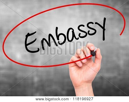 Man Hand Writing Embassy With Black Marker On Visual Screen