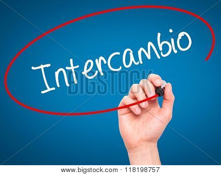 """Man Hand Writing """"intercambio"""" (in Portuguese - Student Exchange Program)  With Black Mark"""