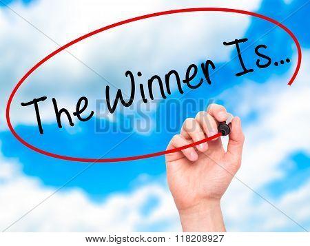 Man Hand Writing The Winner Is