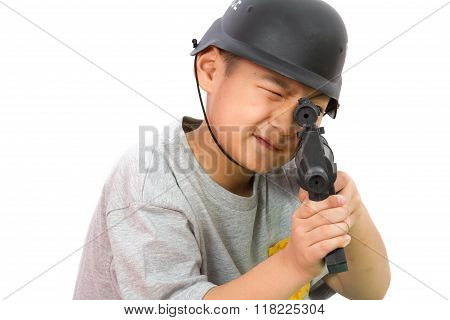 Asian Little Boy Playing Plastic Toy Ak47 With Police Helmet