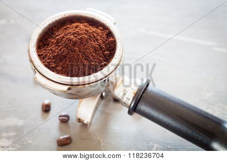 Coffee Grind In Group With Coffee Bean