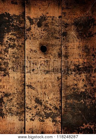 Knot hole of an old wooden wall or fence. Old wood texture.
