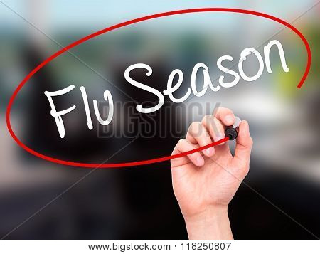Man Hand Writing  Flu Season With Black Marker On Visual Screen