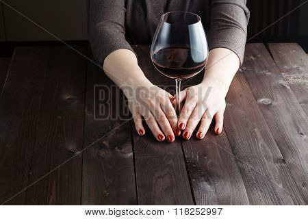 Woman Hand Holds The Wine Glass