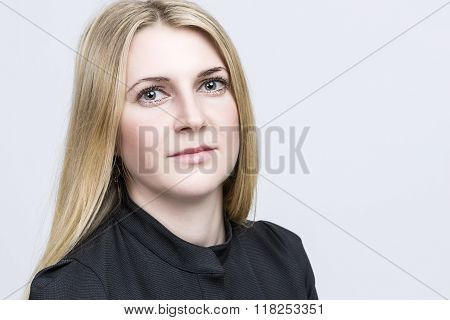Portrait Of Nice Smiling Happy Blond Woman. Caucasian Appearance. Against White