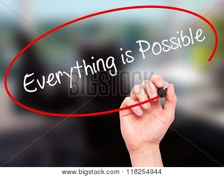 Man Hand Writing Everything Is Possible With Black Marker On Visual Screen