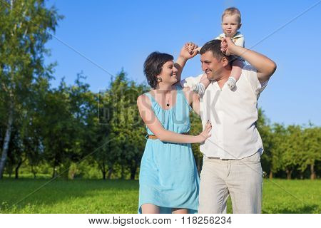 Human Relationships Concepts. Young Caucasian Family Of Three People Having Good Time Together