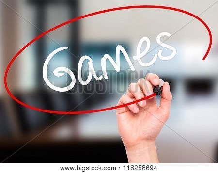Man Hand Writing Games With Black Marker On Visual Screen