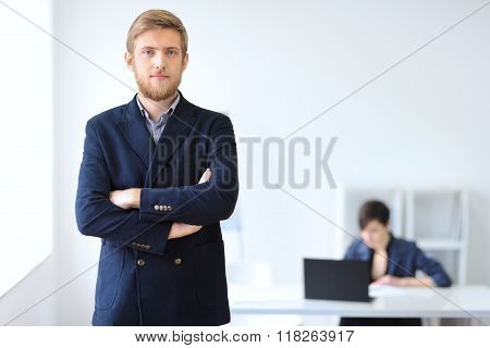 Portrait Of Young Successful Businessman In The Office