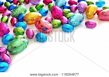 Chocolate Easter Eggs corner border over white