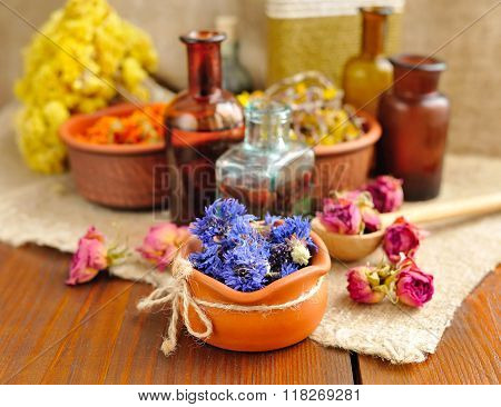 Healing Herbs And Tinctures In Bottles On Sackcloth, Dried Flowers, Herbal Medicine