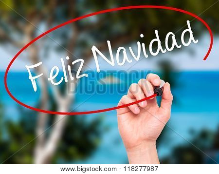 Man Hand Writing Feliz Navidad  (merry Christmas In Spanish) With Black Marker On Visual Screen