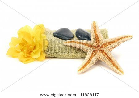 Spa towel, rocks, flower and starfish